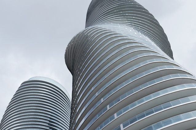 MAD Architects Absolute Towers in Toronto. Nicknamed Marilyn Monroe by the locals, the residential towers, owe their curvaceousness to a pinched waist and continuous balcony line that wraps the building.