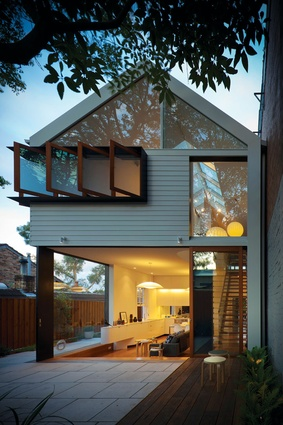 The house is a seamless continuation of the courtyard.